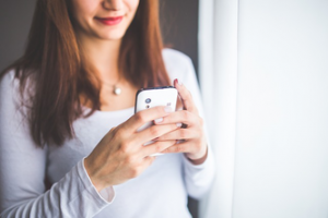 a woman on her cell phone sending a message